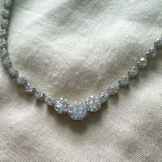 Silver jeweled necklece Silver jeweled necklace, looks really elegant and gorgeous with all outfits! Once worn once to my 16th birthday party years ago Jewelry Necklaces