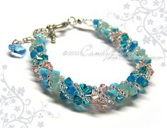 Sparkling in Blue Opal and Turquoise colors - Swarovski twisty bracelet, very beautiful!!!    Length is 7 inches and 2 inches adjustable chain with 10mm Swarovski heart pendant and 9mm. width.
