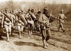 WW1 1916 ; Rumanian soldiers march to war to the company of a violin. -fotolibra