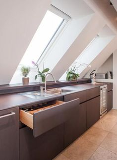 25 Smart Ways To Decorate An Attic Kitchen - a minimalist grey kitchen with a couple of skylights plus additional light - Attic Apartment, Attic Rooms, Attic Spaces, Attic House, Attic Design, Küchen Design, Cocinas Kitchen, Attic Renovation, Kitchen Decor