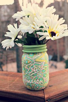 Taking an ordinary Jar and spicing it up. Love it. You could keep this for décor, or make a pencil holder out of it. Maybe even use it to store some lip gloss?