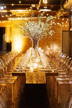 Romantic Candlelit Winter Wedding in Chicago, Long Tables Decorated with Cherry Blossoms | Brides.com