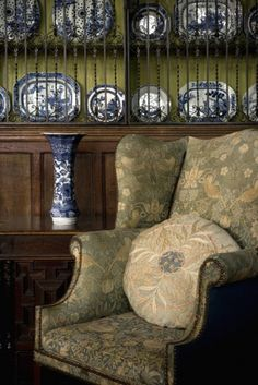 Beautiful 'Strawberry Thief' upholstery   on an amrchair in the Great Parlour at Wightwick Manor, Wolverhampton. Strawberry Thief is one of William Morris's most popular repeating designs for textiles. It takes as its subject the thrushes that Morris found stealing fruit in his kitchen garden of his countryside home, Kelmscott Manor, in Oxfordshire.