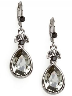"""Black Diamond Drops  10 Credits   Large crystal drops in a black diamond tone are perfect for one of evening's jewel toned frocks. A large teardrop shaped Swarovski crystal is set in silver-tone base metal and has small black rhinestone detail.        * Lever Back Closure      * Materials: Swarovski Crystal, Base Metal      * Length: 1.5"""", Width: 0.5"""""""