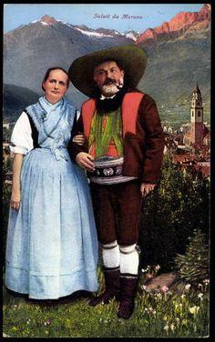 Ansichtskarte / Postkarte Trachten, Saluti da Merano, Paar in Tracht, Südtirol
