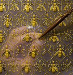 """CONSTELLATION OF 69 BEES, THE SYMBOL OF THE EMPIRE AND THE EMBLEM OF THE GUERLAIN FAMILY OF """"EAUX"""". - SYLVIE DESCHAMPS, MAÎTRE D'ART, HANDCRAFTS """"THE FESTIVE ATTIRE"""", """"L'HABIT DE FÊTE"""", A COVERING DESIGNED AS AN IMPERIAL CORONATION ROBE."""