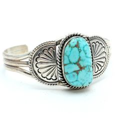 >> Authentic Navajo crafted cuff >> Sterling silver with traditional stamping design  >> One large high grade turquoise stone >> Signed
