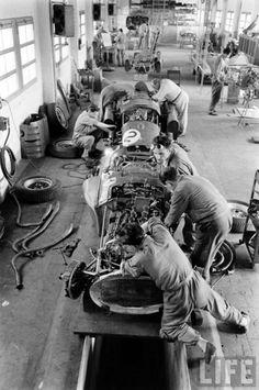 """""""Ferrari mechanics and technicians at Maranello prepare the Lancia/Ferrari D50′s for the Monaco GP. May, 1956."""""""