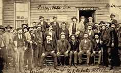 The federal deputies Judge Isaac Parker sent out to capture the lawbreakers in the 1890s included these marshals, posing in front of a land office in Perry, Oklahoma, in 1892. Bruce faced against men with similar dress and weaponry in his 1897 shoot-out. Unless you saw the badge, these marshals looked like pretty much everyone else you encountered in those days.  – Courtesy Susan Swain Peters collection, Oklahoma Historical Society –