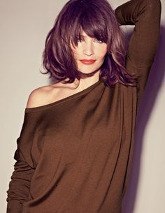 Helena Christensen, lob haircut and olive slub sweater