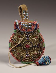 A COMANCHE BEADED HIDE POUCH. . c. 1890. ... American Indian   Lot #77055   Heritage Auctions