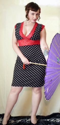 White and black polka dot dress with red lace and deep neckline for maximum cleavage. Cute for the pinup in you.