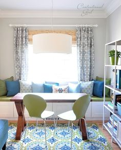 I wouldn't mind having this blue and green study with window seat in my office. Let's make it happen, cap'n!