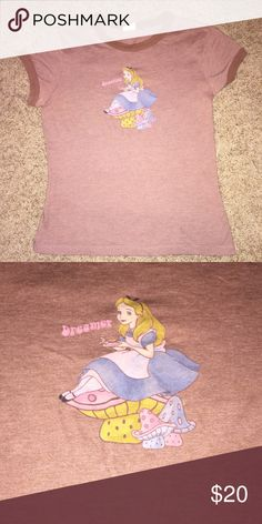 """Alice in wonderland tee Super cute brown tee, cap sleeves with Alice, sitting on a mushroom, having tea and it says """"Dreamer"""" in pink next to her. Really soft, great condition. 🎀 Disney Tops Tees - Short Sleeve"""