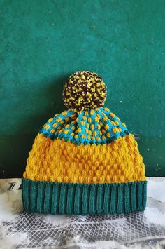 DESCRIPTION<<< A new collection of beanie hats, each featuring a special pattern designed from happening events and a giant pom. The finishing is