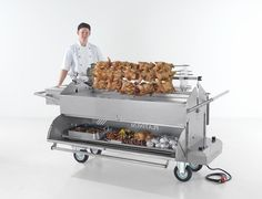 Platinum range of cookers quite a distinctive pig roaster with a lot of different optional extras, this photo shows the chicken spit attachment and what I like about this machine is the hot compartment at the bottom. Commercial Kitchen Equipment, Butcher Shop, Cookers, Kitchen Cart, Business Names, Grills, Food Truck, Conference, Buffet