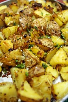 rustic styled roasted potatoes with roasted garlic and sea salt: potatoes, garlic, extra virgin olive oil, thyme, rosemary, cracked black pepper, sea salt, and fresh parsley