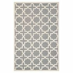 Wool rug with an 8-pointed star motif in silver and ivory. Hand-tufted in India.  Product: RugConstruction Material: WoolColor: Silver and ivoryFeatures: Hand-tuftedNote: Please be aware that actual colors may vary from those shown on your screen. Accent rugs may also not show the entire pattern that the corresponding area rugs have.