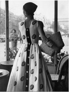 So much is right with this....the headscarf, the arm cuff, the handbag....sigh.... Givenchy, 1952
