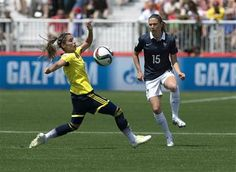 France's Elise Bussaglia, right, and Colombia's Daniela Montoya battle for the ball during the first half of a FIFA Women's World Cup soccer game in Moncton, New Brunswick, Canada, on Saturday, June 13, 2015. (Andrew Vaughan/The Canadian Press via AP) MANDATORY CREDIT  ▼13Jun2015AP|Colombia stuns France 2-0 in Women's World Cup http://bigstory.ap.org/article/dd8df65b89814f8294ead21b77ab4424 #2015_FIFA_Womens_World_Cup #Group_F_France_vs_Colombia