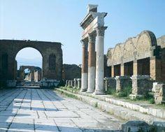 *POMPEII, ITALY ~ The Forum showing the entrance on the right of Macellum, Pompeii (UNESCO World Heritage List, 1997), Campania. Roman Civilization, 1st Century.