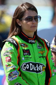 Danica Patrick, driver of the No. 10 GoDaddy Chevrolet, stands on the grid during qualifying for the NASCAR Sprint Cup Series Cheez-It 355 at The Glen at Watkins Glen International on August 10, 2013 in Watkins Glen, New York.