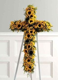 SunFlower Cross (CF106-21) Funeral Flowers, Sympathy Flowers, Funeral Flower Arrangements from San Francisco Funeral Flowers.com Search for chinese funeral, sympathy funeral flower arrangements from our SanFranciscoFuneralFlowers.com website. Our funeral and sympathy arrangements include crosses, casket covers, hearts, wreaths on wood easels, coronas fúnebres, arreglos fúnebres, cruces para velorio, coronas para difunto, arreglos fúnebres, Florerias, Floreria, arreglos florales, corona…