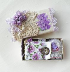 Altered matchbox in cream and lilac purple including vintage treasures inside.