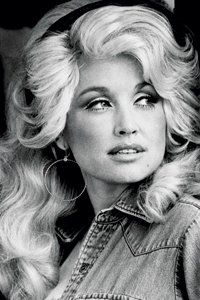 Dolly moved to Nashville at 18 where she signed to a record company to write country songs. Country music had a big influence on her wardrobe, and here you can see her wearing one of her signature denim cowboy shirts complimented with some fabulous '60s style make-up!