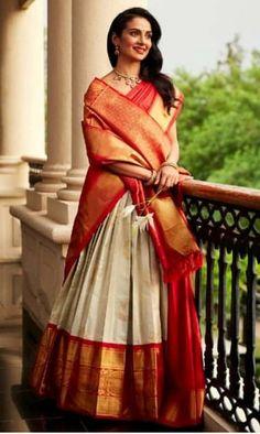 23 Elegant Saree Lehenga Designs For The South Indian Brides! 23 Elegant Saree Lehenga Designs For The South Indian Brides! Indian Lehenga, Lehenga Saree Design, Silk Lehenga, Silk Sarees, Indian Gowns, Indian Wear, Kanjivaram Sarees, Silk Dupatta, Bridal Lehenga