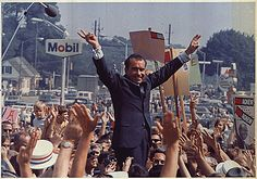 President Richard Nixon giving his signature victory sign