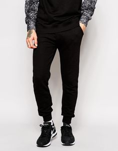 """Joggers by Eleven Paris Smooth jersey Stretch waistband Two side pockets One contrast pocket to reverse Stretch ribbed cuffs Skinny fit - cut closely to the body Machine wash 80% Cotton, 20% Polyester Our model wears a size Medium and is 6'1""""/185.5 cm tall"""