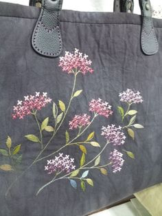 From an unknown South Korean maker - look closely at the larger view - The embroidery is really not complex - satin-stitch leaves, stem-stitch, 4 lazy-daisy petals to make one floret. But the shading of the pink and purple and of the leaves elevates the thing, and gives a nicely impressionistic sense of lilacs.