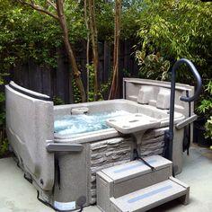 Hand rails make hot tub access easy.