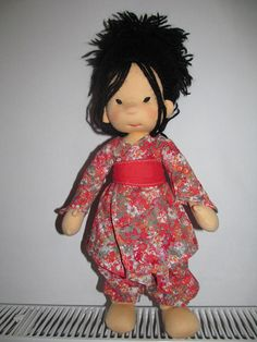 A 42-45 cm. doll ,made of natural materials ,stuffed with pure wool.The doll can be dressed in multiple variations .Its included outfits contains the crocheted shoes and the knitted coat.  This doll has been sold and the same doll can not do it again, but I can do a more beautiful