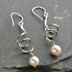 This stunning earring design is perfect for any party! Make your own pair with supplies at http://www.ninadesigns.com/jewelry_design_ideas/Spiral_Pearlescent_Earrings.html