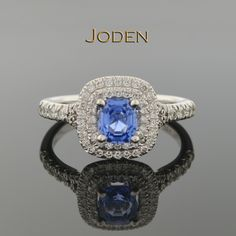 The star of this striking ring is a 1.11 carat cushion cut sapphire that has not been heated to enhance it's beautiful blue color. Unheated blue sapphires are unusual to come by as there color is often to dark or too light and therefore heated to bring out a more desirable color. Accenting the design are 66 round brilliant cut diamonds that have a weight of approximately .42 carat total weight. These diamonds have an average color grade of G-H and an average clarity grade of VS(1-2).