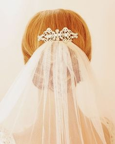 Crystal comb to hold the veil in place.