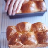 When done, the loaves will look puffed, glossy, and golden-brown on top, and register 190°F internally.