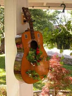 good use for an old guitar but it would kill me somewhere deep inside because the music wouldn't play...