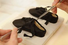 Queen Victoria Baby Shoes. Black silk baby shoes worn by Queen Victoria at Kensington Palace in London.