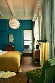 http://jensen-beds.com/ - like this green color combination. Teal bedroom walls with gold throw and green velvet chair / sfgirlbybay