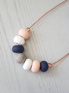 Check out this item in my Etsy shop https://www.etsy.com/au/listing/559530868/polymer-clay-necklace-navy-blue-granite