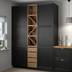 """For a small kitchen """"spacious"""" it is above all a kitchen layout I or U kitchen layout according to the configuration of the space. Wine Shelves, Wine Storage, Kitchen Storage, Tall Cabinet Storage, Pantry Cabinet Ikea, Ikea Kitchen Pantry, Wall Pantry, Crate Shelves, Record Storage"""