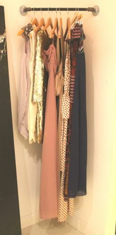 corner dress rail...maybe for coats in a corner of an entry