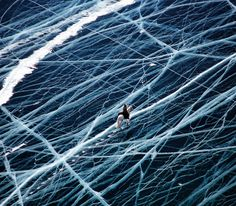 _    Ice Rider Crosses World's Oldest Lake    French photographer Matthieu Paley is the person behind this almost unbelievable photo called Ice Rider. It was taken in Siberia.