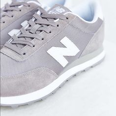 New Balance Grey 574 Sneakers New Balance Grey 574 Sneakers, 7.5 size, these were purchased from Urban Outfitters (believe they are still up on the site). They are like a lilac-light grey color. Some marks/wear on white rubber part but it can be cleaned and they are still in great condition, tons of life left in them. New Balance Shoes Sneakers