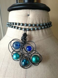 Vintage blues and greens with funky wire work by Kris Lanae  www.cherishdesigns.wordpress.com