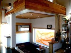 """a more modern take on a tiny house - some interesting ideas here (smaller loft, elevated """"hall"""" with storage underneath)"""