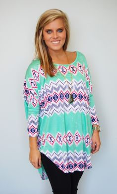 Aztec has been a best seller this season, and we love this pattern on this piko top. Make a statement and be 100% comfortable in it! Our model is 5'3 and is wearing a small.